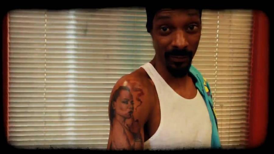 Snoop Dogg's right arm woman tattoo