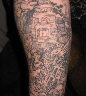 Spooky graveyard sleeve tattoo