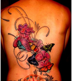 Stunning orchid back tattoo