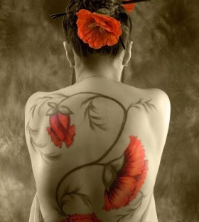 Stunning poppy flower back tatttoo