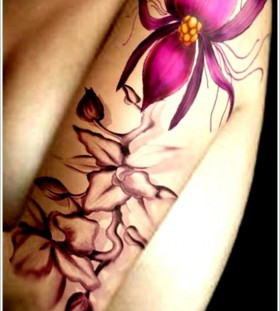 Stunning purple orchid arm tattoo