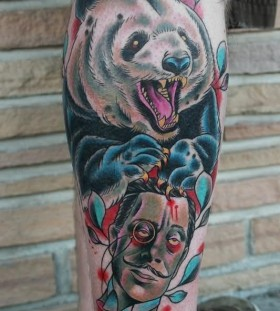 Terrifying panda bear leg tattoo