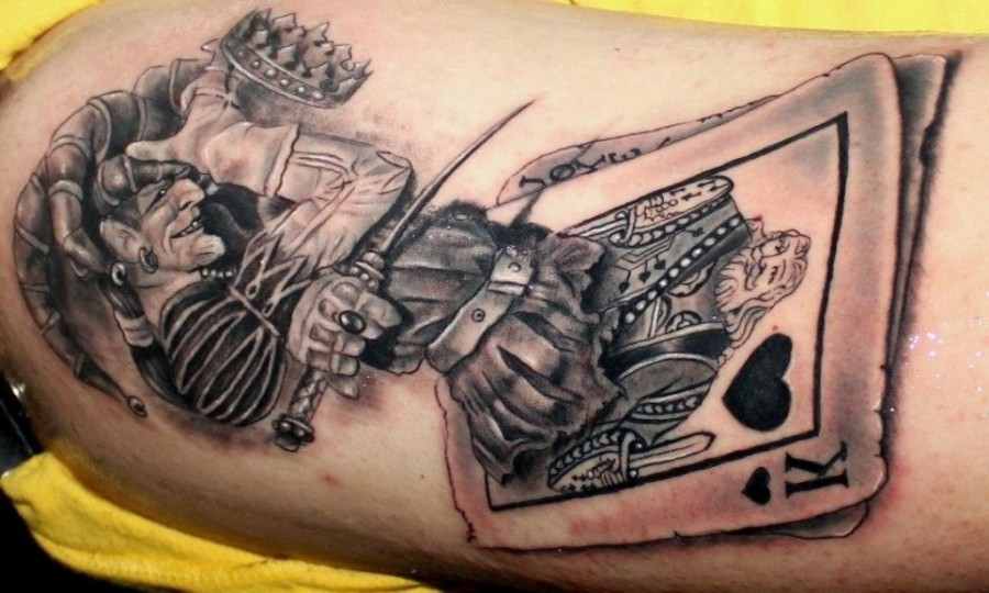 The joker and king tattoo