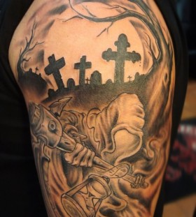 Thrilling cemetery arm tattoo