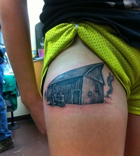 Tractor in a farm tattoo