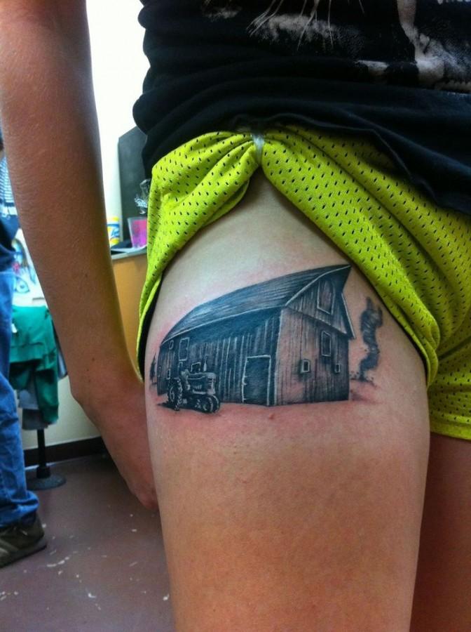 Tractor in a farm tattoo