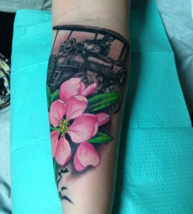 Tractor in flowers tattoo