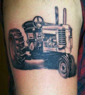 Tractor tattoo on arm