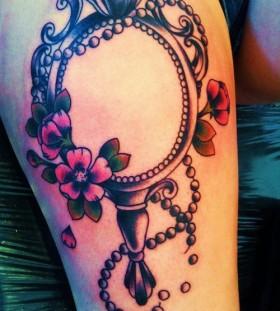 Vintage mirror leg tattoo