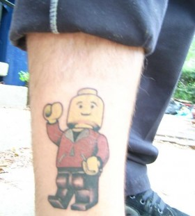 Walking lego man tattoo