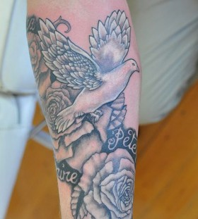 White ink dove arm tattoo