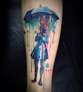 Women's and umbrella watercolor tattoo
