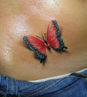Women's hip red butterfly tattoo