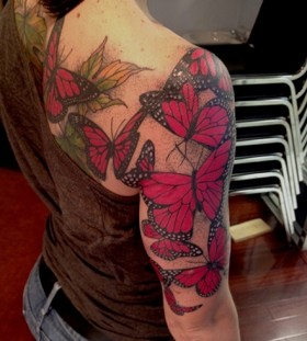 Women's shoulder and back red butterfly tattoo
