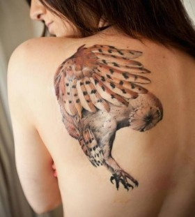 Women's shoulder owl tattoo