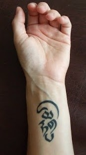 Wrist black Tara Mantra tattoos