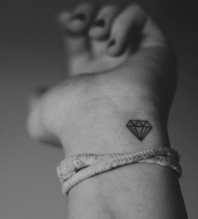 Wrist black diamond tattoo on arm