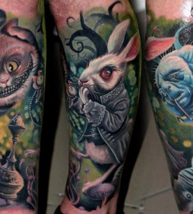cheshire cat and rabbit leg tattoos