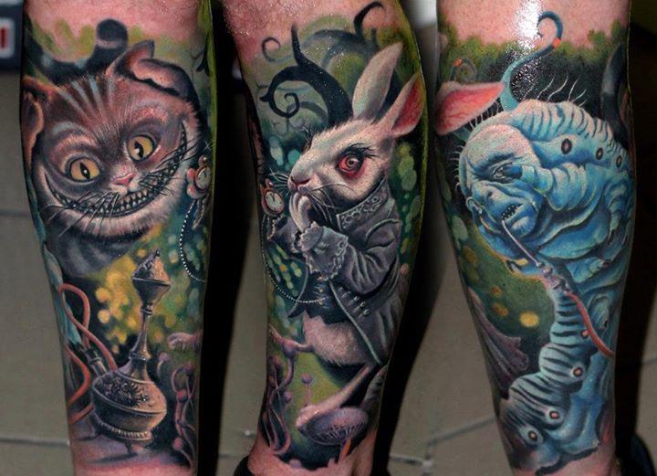 cheshire cat and rabbit leg tattoos