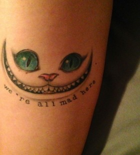 cheshire cat arm tattoo with quote