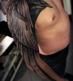 Cool looking black birds tattoo on arm