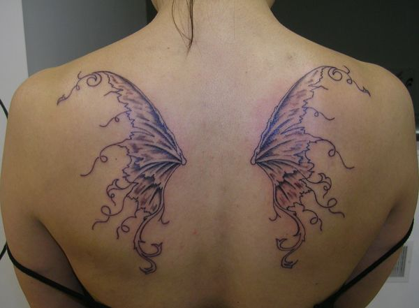 Fairy wing tattoo curved