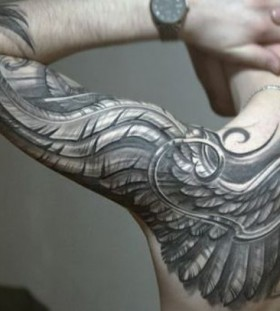 Gorgeous black wings tattoo on arm