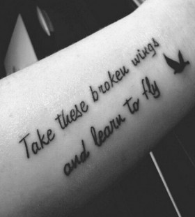 Pretty quote and wings tattoo on arm