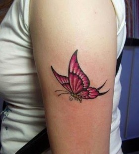 Red butterfly wing tattoo on arm
