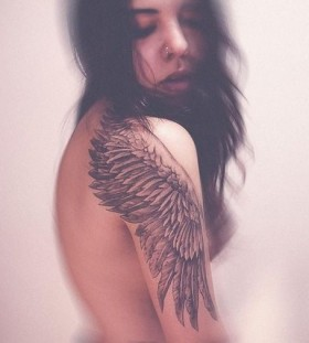 Simple girl's wings tattoo on arm