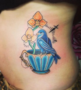 Teacup and blue bird tattoo