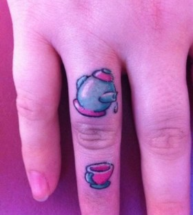 Teacup and teapot finger tattoo