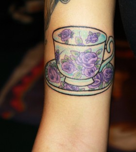 Teacup with purple roses tattoo