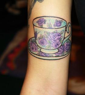 Teacup with purple roses tattoo