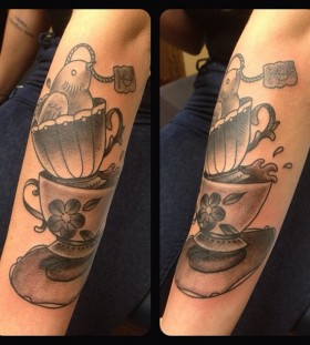Teacups and bird tattoo