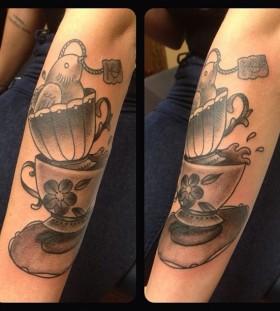 Teacups and bird tattoo