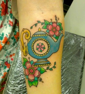 Teapot and flowers tattoo