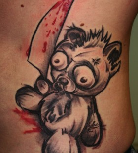 Teddy bear with a knife tattoo