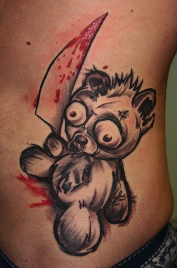 Teddy bear with a knife tattoo