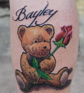 Teddy bear with rose tattoo