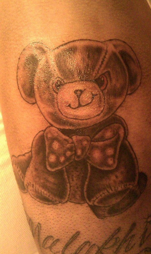 Teddy with a bow tie tattoo