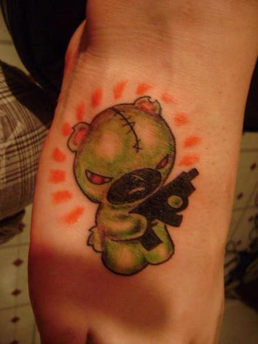 Teddy with a gun tattoo