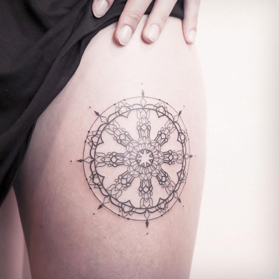 the wheel of dharma dattoo by xoxotattoo