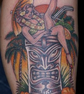 Tiki and woman tattoo
