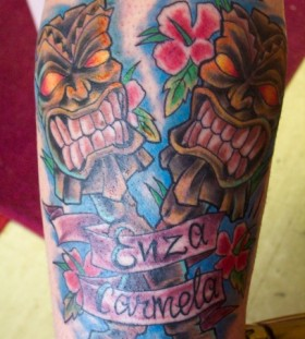 Tiki and writing tattoo