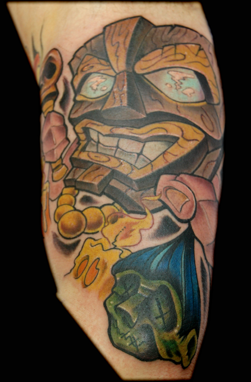 Tiki mask tattoo
