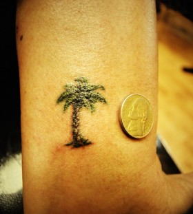 Tiny palm tree tattoo