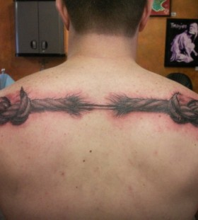 Torn rope back tattoo