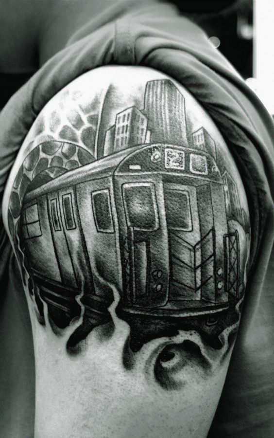Train and buildings tattoo