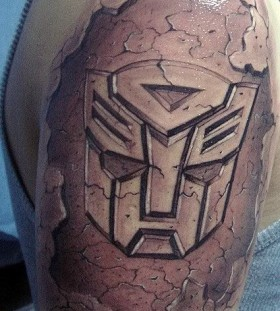 Transformers logo arm tattoo